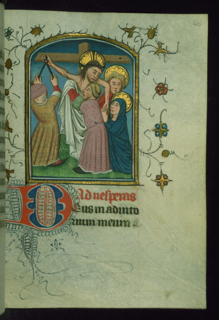 A manuscript miniature of Jesus being taken down from the Cross.